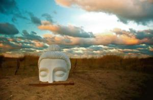 White buddha sculpture in the dunes and sand prairie of Loyola Park in Rogers Park